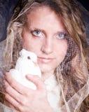 Woman with white dove Stock Photos