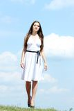 Woman in white dress Stock Image