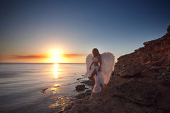 Woman in white dress as an angel royalty free stock photography