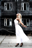 Woman in a white dress at the background of the old house Royalty Free Stock Photos