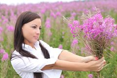 woman in a white dress on a background of tall grass Stock Photo