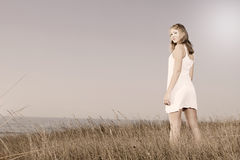 Woman in a white dress Stock Images