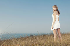 Woman in a white dress Royalty Free Stock Image