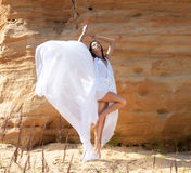 Woman in white dress dancing on the desert Royalty Free Stock Photography