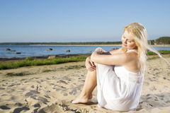 Woman in white dress feeling wind flow Stock Images