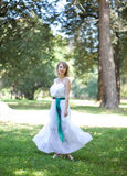Woman in white dress in green park. eco green concept. Stock Photo