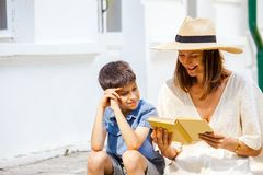 Woman reading a funny book to a boy Stock Photography