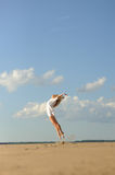 Woman in white dress jumping Stock Image