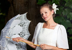 Woman in a white dress and with a lace umbrella Royalty Free Stock Images