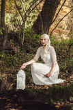 Woman with white dress and lantern in a forest Royalty Free Stock Images