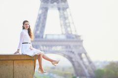 Woman in white dress near the Eiffel tower in Paris, France Royalty Free Stock Photo
