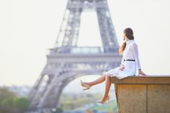 Woman in white dress near the Eiffel tower in Paris, France Stock Photography