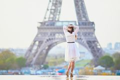 Woman in white dress near the Eiffel tower in Paris, France Royalty Free Stock Images