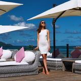 Woman in white dress near poolside Stock Image