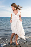 Woman in white dress near the seaside stock photography