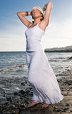 Woman in white dress near the seaside Stock Image