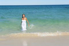 Woman in white dress in ocean Royalty Free Stock Photos