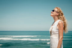 Woman in a white dress on the ocean coast Stock Photos