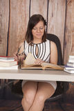 Woman white dress office book glasses smile stock photo
