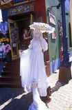Woman in white dress and parasol at entrance of Ala Boca, art area for tourists in Buenos Aires, Argentina Stock Photography