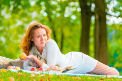 Woman in a white dress on a picnic Royalty Free Stock Image