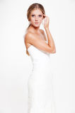 Woman in white dress posing Royalty Free Stock Photo