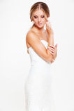 Woman in white dress posing looking down Royalty Free Stock Photography