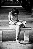 Woman with white dress reading at tuileries garden Stock Photo