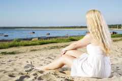 Woman in white dress relax on beach Royalty Free Stock Photo