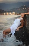 Woman in white dress relaxing in sea Royalty Free Stock Photography