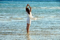 Woman in white dress in sea Stock Photos