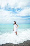 Woman in white dress on the seashore Stock Photo