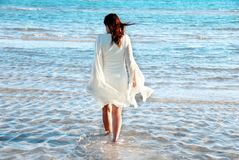 Woman in white dress at seaside Stock Photo