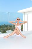 Woman in White Dress and Shades for Fashion Shoot Stock Photos