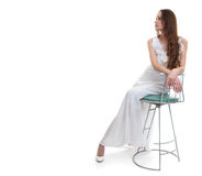 Woman with white dress sitting on chair in studio royalty free stock photos