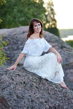Woman in a white dress sitting Royalty Free Stock Photo