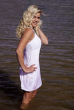 Woman white dress stand in water Stock Photography