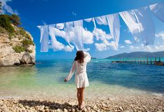 Woman in white dress standing on beach Royalty Free Stock Photo