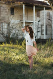 Woman in White Dress Standing on Green Grass Near House Stock Photos