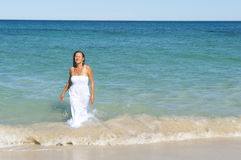 Woman in White Dress swimming in ocean Royalty Free Stock Images