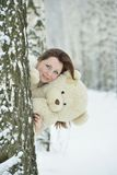 Woman in white dress with teddy bear Royalty Free Stock Image