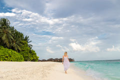 Woman in a white dress on the tropical beach Royalty Free Stock Image