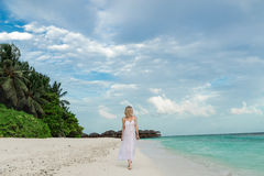 Woman in a white dress on the tropical beach Stock Photography
