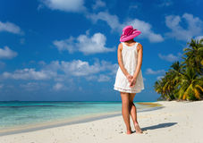 Woman in a white dress on the tropical beach Stock Image