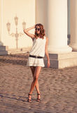 Woman in white dress walking around old city Stock Photos