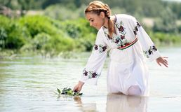 Woman in White Dress in the Water at Daytime Stock Photography