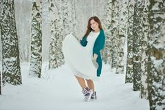 Woman in white dress in winter forest Stock Images