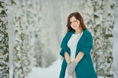 Woman in white dress in winter forest Stock Photography