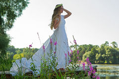Woman in a white dress and a wreath Royalty Free Stock Photo