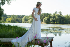 Woman in a white dress and a wreath Royalty Free Stock Photography
